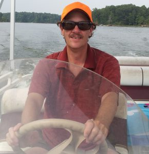 Paul Swarthout drives the pontoon boat on Mill Creek Lake near Marshall, IL